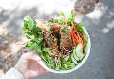 Nem Nuong Cay Mia (BBQ Pork Meatballs on Sugar Cane Skewers). From Thai Phi of Pink Bellies Food Truck, Charleston, South Carolina.  Photo by Victoria Paramenter.