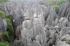 """Stone Forest- Yunnan, China     """"This is a truly beautiful place and the experience of walking through the 'forest' will take your breath away."""""""