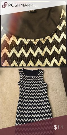 Forever 21 chevron dress Black and gold- subtle sparkle chevron print. The length is a little above the knee (I am 5'3). Never worn. Forever 21 Dresses Midi