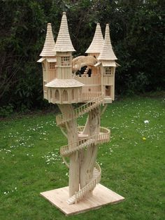 Wood fairytale castle on stilts, a Bough House sculpture by Rob Heard of the U.K. Facebook: https://m.facebook.com/boughhouse/  His Bough House website: http://www.boughhouse.co.uk