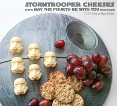 Star Wars Food: Stormtrooper Cheese Helmets (from silicone mold) and Death Star plate / Check out blog for lots of Star Wars Party food recipes and downloadable labels! Great for Birthday Party or a May the Fourth be with you Party. / #starwars #starwarsparty #maythefourthbewithyou #starwarsbirthday #starwarsfood #foodart #stormtrooper #finn #theforceawakens #clonewars #rougeone #parmesan #gouda #cheese #traderjoes #siliconemold #siliconetray #Kotobukiya / maythefourthbewithyoupartyblog.com