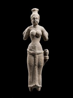 Durga Pre-Angkor period Date: ca. 6th century Culture: Southern Cambodia Medium: Sandstone This is one of the oldest Brahmanical sculptures discovered in Cambodia. Although Durga is most often associated in South Asia with her form as the Unconquerable One-the slayer of the buffalo demon Mahisha-here she is in her benign four-armed form, identifiable by her one surviving attribute, the bell. National Museum of Cambodia, Phnom Penh