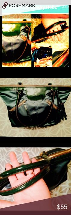 "•FLASH SALE!• KATE LANDRY Moss & Gold Satin Hobo Barely used, Chic & Roomy, this Genuine Satin KATE LANDRY hobo bag in a breathtaking Emerald green features tons of room for all your must haves on the go, shiny gold hardware, playful leather tassels w/ a to die for lining that's a pure silk/poly fabric in ""warm goldenrod"". Lightweight while so roomy! The bags inner has: large side pouch, two smaller side by side pockets. Subtle gold hardware accents add an edge on the outside which securely…"