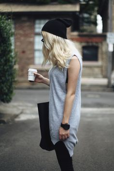 gray tee. knit hat. oversized bag.