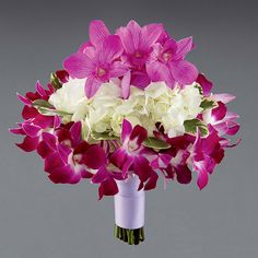Bouquet with lavender dendrobium orchids, white hydrangeas, and purple double dendrobium orchids