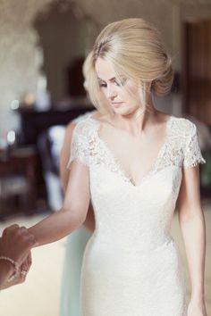 elegant updo wedding hairstyle; photo: Craig and Eva Sanders Photography
