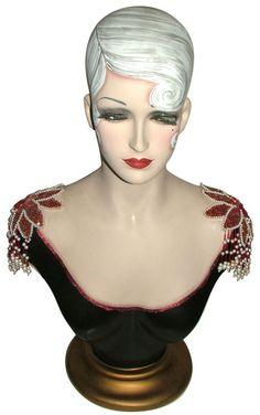Gorgeous vintage Art Deco mannequin/bust.Hand painted with decorative shoulder pads and of the highest quality. Signed by the artist. NOW SOLD