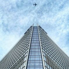 Canary wharf from bottom to top with a plane flying straight over. Great photo taken by @bodzofficial  ____________________________________ #canarywharf #london #londonlife #thisislondon #igers #igerslondon #ilovelondon #sky #skyscraper #skyline by canary___wharf