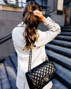 Trench coat & black Chanel bag