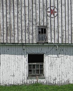 Photo of an old, weathered white barn with a red rosette hex sign and broken barn windows. Board & batten siding and broken windows finish this rustic treasure.  This print is now available on my Etsy shop at www.etsy.com/shop/AnneFreemanImages  I ship worldwide.  Click on the link for print details and to order.   ~ Anne Freeman Images ~ Prints to Make you Smile ~ White Barn With Hex Photo  Rustic Fine Art by AnneFreemanImages