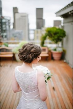 An elegant twisted updo with a satin A-line wedding dress from @reemacra {@janegphoto}