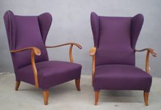 Elegant pair of lounge chairs in the style of Paolo Buffa