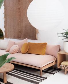 Velvet couch, love the pink and gold cushion