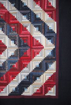 patriotic red white and blue log cabin #quilt in a barn raising setting