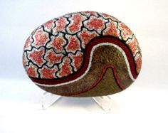 Unique OOAK 3-D Art Object, Hand Painted Rock, Signed Numbered, Multi Colors, Collectible, Home or Office Decor, Decorative Art, Conversation Piece. Gift for Her or Him.    The rock has a matte, black background with colored shapes, in red, blue, green, and purple, outlined with metallic colors and gold. The black band is, is also, bordered with metallic gold. My painting medium is acrylic paint and acrylic dye. I use acrylic varnish to seal the stone. The Stone is signed, numbered, and…