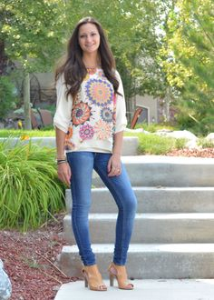 """This spring Floral print chiffon blouse features a sheer chiffon tunic styled with ruched pleating on the back, high on front low on back to cover """"the base"""" , front lining and detailed 1/2 sleeve , perfect to wear with leggings, jeans or skirt!"""