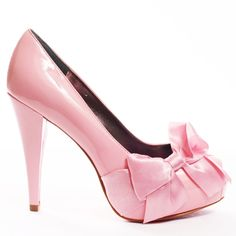 Feel fancy and free in these heels from Paris Hilton. Destiny features pink patent leather throughout. This peep toe pump is topped with a pretty pink fabric bow at the front side. A 4 inch heel and 1 inch platform complete this flirty shoe.