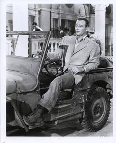 John Wayne in A Willys Jeep John Wayne, Iowa, Westerns, Jeep Scrambler, Military Jeep, Military Vehicles, Willys Mb, Old Jeep, Jeep Life