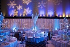 "Stunning ""Winterlicious"" Bat Mitzvah. Winter inspired silver manzanita trees, White Branch explosion, hanging crystals, twinkle light backdrop, Fresh white florals."