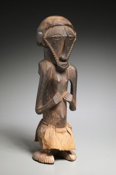 Male Figure, late 1800s-early 1900s      Central Africa, Democratic Republic of the Congo, Pre-Bembe, late 19th-early 20th century      wood, cloth, Overall - h:48.60 w:15.60 d:17.20 cm (h:19 1/8 w:6 1/8 d:6 3/4 inches).