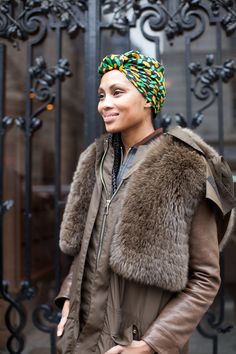 Paris Street Style Couture 2013. A bright patterned head scarf lends interest to a brown leather jacket.