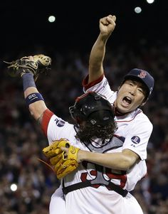 Boston Red Sox relief pitcher Koji Uehara, rear, and catcher Jarrod Saltalamacchia celebrate the Red Sox 5-2 win over the Detroit Tigers in Game 6 of the American League baseball championship series on Saturday, Oct. 19, 2013, in Boston. The Red Sox advance to the World Series. (AP Photo/Matt Slocum)
