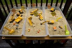 "construction themed ""sensory table"" Add different 'loads', sand, rice etc. What happens if we try to move water?"