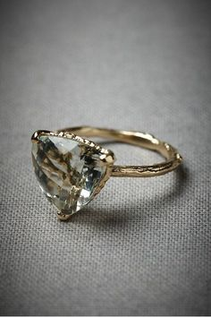 I like the unique shape of the gem, and the tree bark-style of the band. Very pretty and interesting.