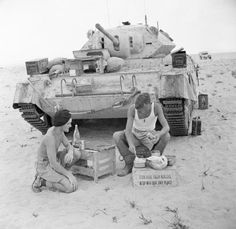The crew of a Crusader tank prepare a meal in the Western Desert, 20 September 1942.  #worldwar2 #tanks