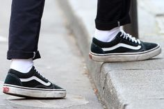 Closeup of Kristen Stewart's dirty and beat-up black Vans 'Old Skool' sneakers