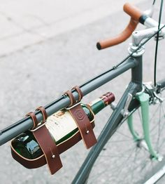 Port your pinot securely (and stylishly) on bike with this hands free leather bottle carrier. Adjustable straps attach to the top tube of your ride, and the caddy design holds the front and back of the bottle tightly in place. The wine carrier also fits 750mL liquor bottles, meaning you and your bike can be picnic or party ready at all times.