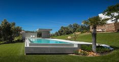 Swimming Pool by Mario Martins Atelier. Concrete isolated infinity pool