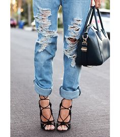Aimee Song  Wearing: One Teaspoon boyfriend jeans; Givenchy Antigona Satchel Bag ($2405); Giuseppe Zanotti Lace-Up Suede Gladiator High-Heel Sandals ($1195).