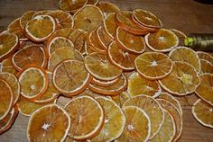 DIY Dried Oranges in the oven---but could also be done in a dehydrator or air dried on screens. Great for primitive Christmas decorating.