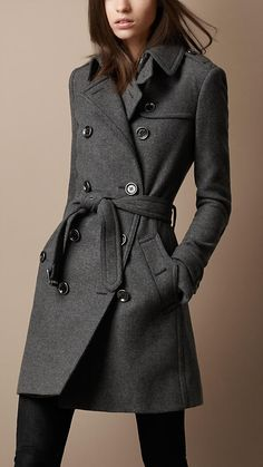 Burberry.  I absolutely love this coat.  The collar, the buttons, the tied sash, the gray color is perfect. very flattering!