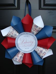 I love my new patriotic front door wreath!!   I had fun putting this together, although I must admit this is more of an adult craft than one...