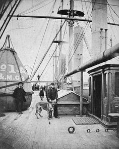 Captain Halpin and his dog aboard the 'Great Eastern'. 1873. National Maritime Museum.