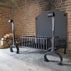 Large hand forged fire basket and fire dogs for the inglenook fireplaces of an English Manor house, 2015