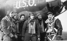 """Walter Cronkite and the aircrew after a mission over Europe on a B-17 with the nose art """"U.S.O."""""""