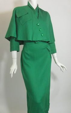 Not everything needs to be skin tight; I think maybe we've forgotten that. 1940s green rayon dress with cape, DCV archives.
