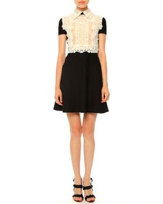 """Valentino lace and crepe couture dress. Approx. length: 36.5""""L down center back. Spread collar. Short sleeves. Nips at the natural waist. Fitted bodice; A-line skirt. Hidden back zip. Lace, cotton/pol"""