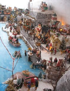 Marie does an outstanding Christmas Village Display including a seaport.  The display boards and tiers are all handcrafted by her as are many of her decorative items.  Check out all the beautiful details she puts into her work.
