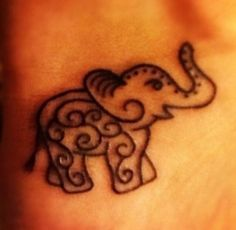 Small elephant tattoo - I think Laura and I should get something like this