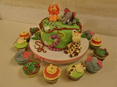 Love the cupcakes around the cake.  They are each so cute! This would work for a baby shower as well!