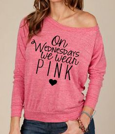 "[obsessed with Mean Girls, I must have this] ""On Wednesdays We Wear Pink"" - Quote from the movie Mean Girls. Professionally vinyl pressed. Slouchy Pullover is ultra-soft and perfectly draped for a flattering fit. This versatile, lightweight sweatshirt features a wide neck opening and raglan sleeves."