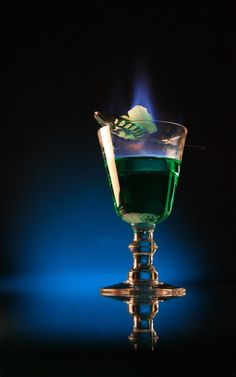 Absinthe with Burning Sugar Spoon - there is some controversy about whether the sugar with absinthe should be lit or not but this makes for quite a spectacle!