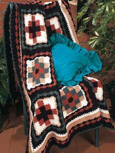 Navajo Quilt, free pattern - This blanket is worked in large 11-inch squares, rather than a lot of small ones as it appears to be. Really interesting way of doing this by starting a block in the middle, then crocheting each square of color off the sides of the center block, working your way around. Lengthy instructions, but concept is simple. . . . . ღTrish W ~ http://www.pinterest.com/trishw/ . . . . #crochet #afghan #throw