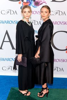 Ashley and Mary-Kate and Olsen pair their all-black designs by The Row with emerald-stone earrings to the 2014 CFDA Fashion Awards. - ELLE.com