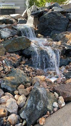 Backyard Stream, Backyard Water Feature, Ponds Backyard, Backyard Landscaping, Diy Pondless Waterfall, Garden Waterfall, Japanese Garden Backyard, Garden Design Plans, Sloped Garden