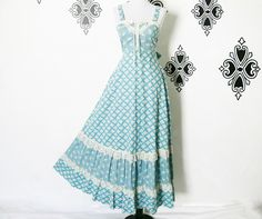 Vintage 70s Lace-Up Prairie Sun Dress XS S Blue Calico Floral Corset Top Ruffled Lace Trim by PopFizzVintage on Etsy https://www.etsy.com/listing/229228503/vintage-70s-lace-up-prairie-sun-dress-xs